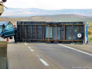 I80 in NV Modern RV on trail without sway control, blocking road.