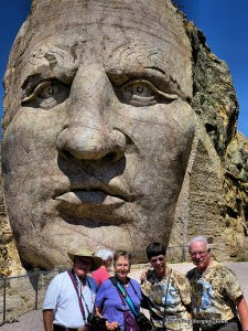 Phyllis and Larry with friends Robert and Cassandra on the arm on the Crazy Horse Monument