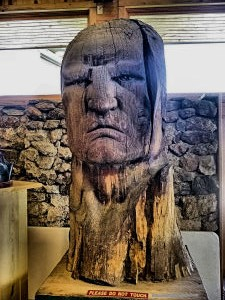 Portrait of Crazy Horse in wood.