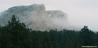Crazy Horse Monument appears mysterious in fog..